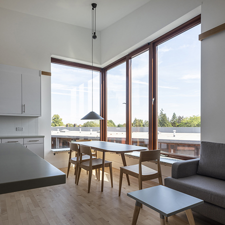 Pale maple floors form backdrop to new student accommodation
