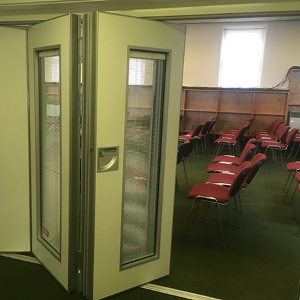 Beehive glazed partition with integral blinds offers the best of both