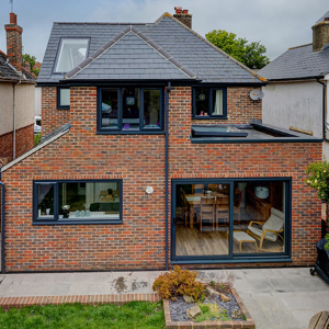 Stock roof windows help to floor this modern extension with natural light