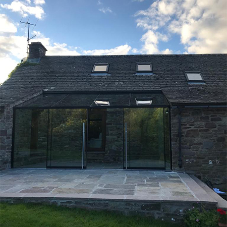 New glass extension for picturesque cottage in Wales