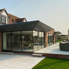 Contemporary countryside extension finished with bespoke Guttercrest products