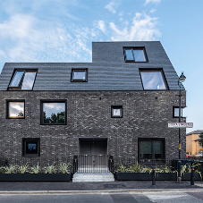 CUPACLAD is the logical choice for striking leaning housing block