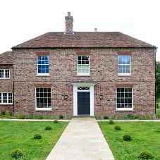 New slim box sash windows help retain the character of this West Sussex home