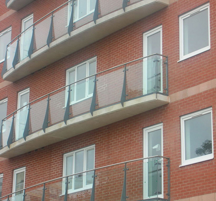 Balcony balustrades with toughened glass infill panels