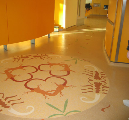nora® Savannah-themed kaleidoscope-like inlays for orientation and floor-marking at Evelina Children's Hospital