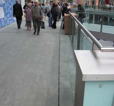 The ACO drainage system removes rainwater efficiently and quickly, ensuring the surface is safe for shoppers