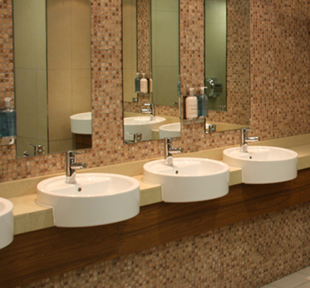 Jasper Morrison basins in granite vanity tops installed at Ayr Racecourse