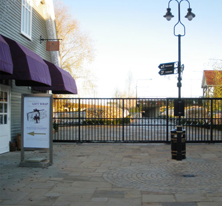 The sectional sliding gate secures the shopping area out of hours