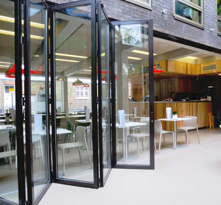 SF45 sliding/folding partitions from the Sunflex range help divide the cafe at the Forge Venue, Camden