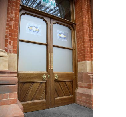 The huge solid-oak doors to the booking office now feature modern door springs and electro-magnetic closers