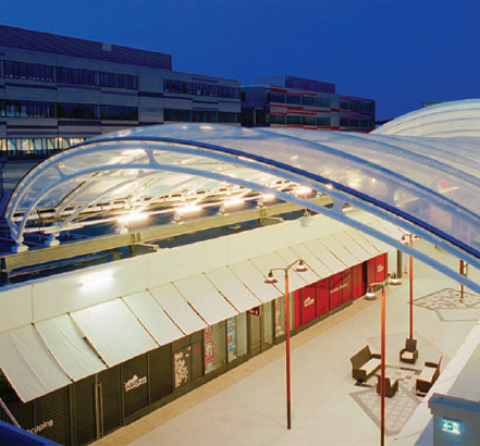The centre is an open street shopping mall with a transparent roof structure