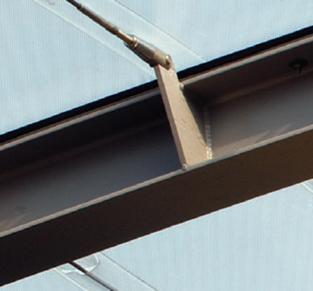 Steel that is media blasted, primed and liquid painted provides structural support for the roof