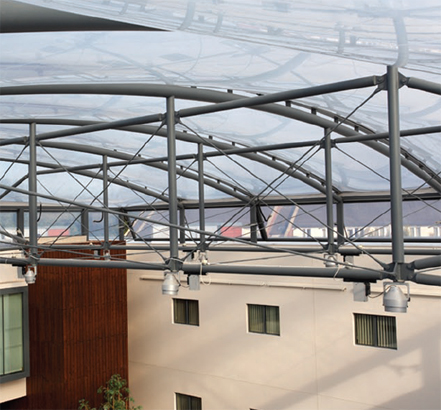 The slightly curved, transparent roof brings light and warmth in to the hospital