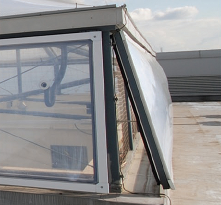 Mechanically operated side vent panels allow for ventilation