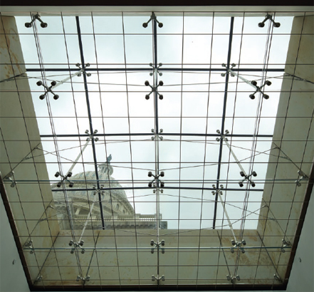 Structural support for the glass is provided by stainless-steel tension rod trusses
