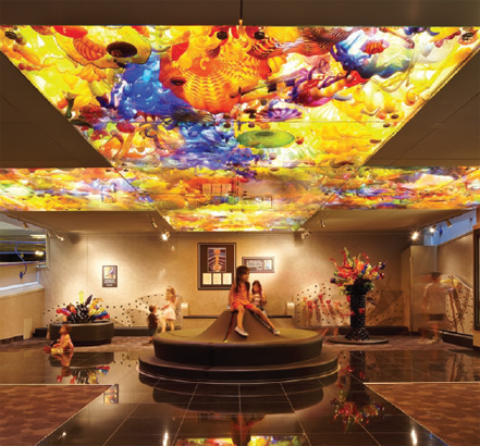 The base serves as a colorful ceiling for an activity centre for children on the first level of the museum