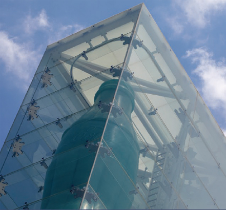 The glazing is supported by a tension structure with stainless-steel cables and laminated glass fins