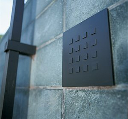 The keypad fits precisely between two joins in the natural stone wall