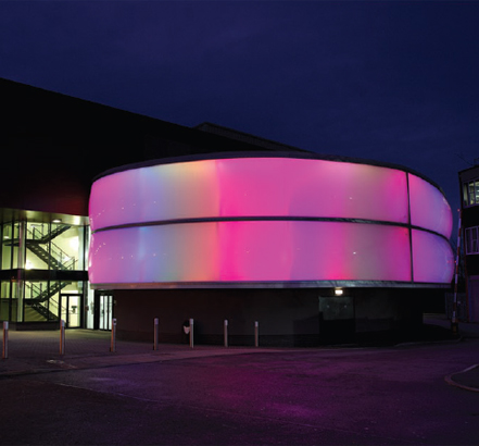 Curved, ETFE pillow facade with an integral LED lighting system