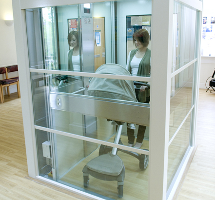 Enclosed in a glass shaft, the lift offers scenic and convenient travel between the ground-floor reception area and the first-floor consulting rooms
