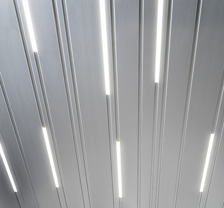 Luxalon Lightlines fit into the joints of the Luxalon Multi-panel ceiling range