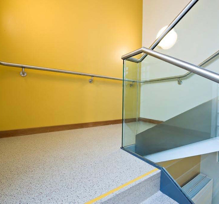 Glass Age™ balustrades are used in the landing area showing the stainless-steel handrail