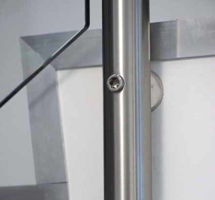 Showing the stainless-steel post, side-mounted to the stair stringer