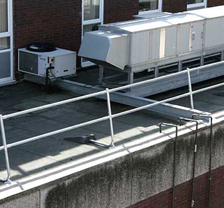 The guardrail provides fall protection for the roof