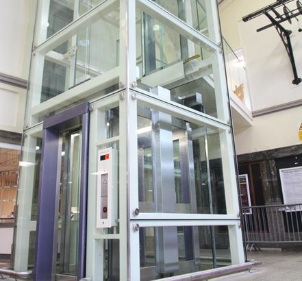Two-stop, through-door glass passenger lift from Stannah, in-situ at Cardiff Central Station