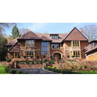 Leaded light Oak casement windows, French and bi-fold doors for Beaconsfield residence.