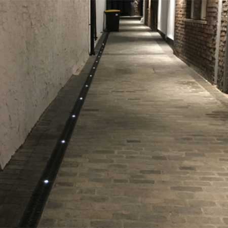 Lighting & drainage system for historical courtyard