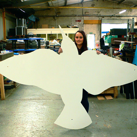 Product Engineer Laura Young with large starling