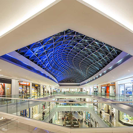 Large skylights illuminate shopping mall for Large skylights