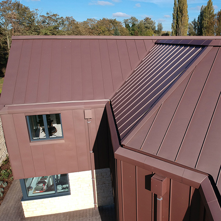 A continuous folded galvanised profile gives full cover of the roof sheet on either side