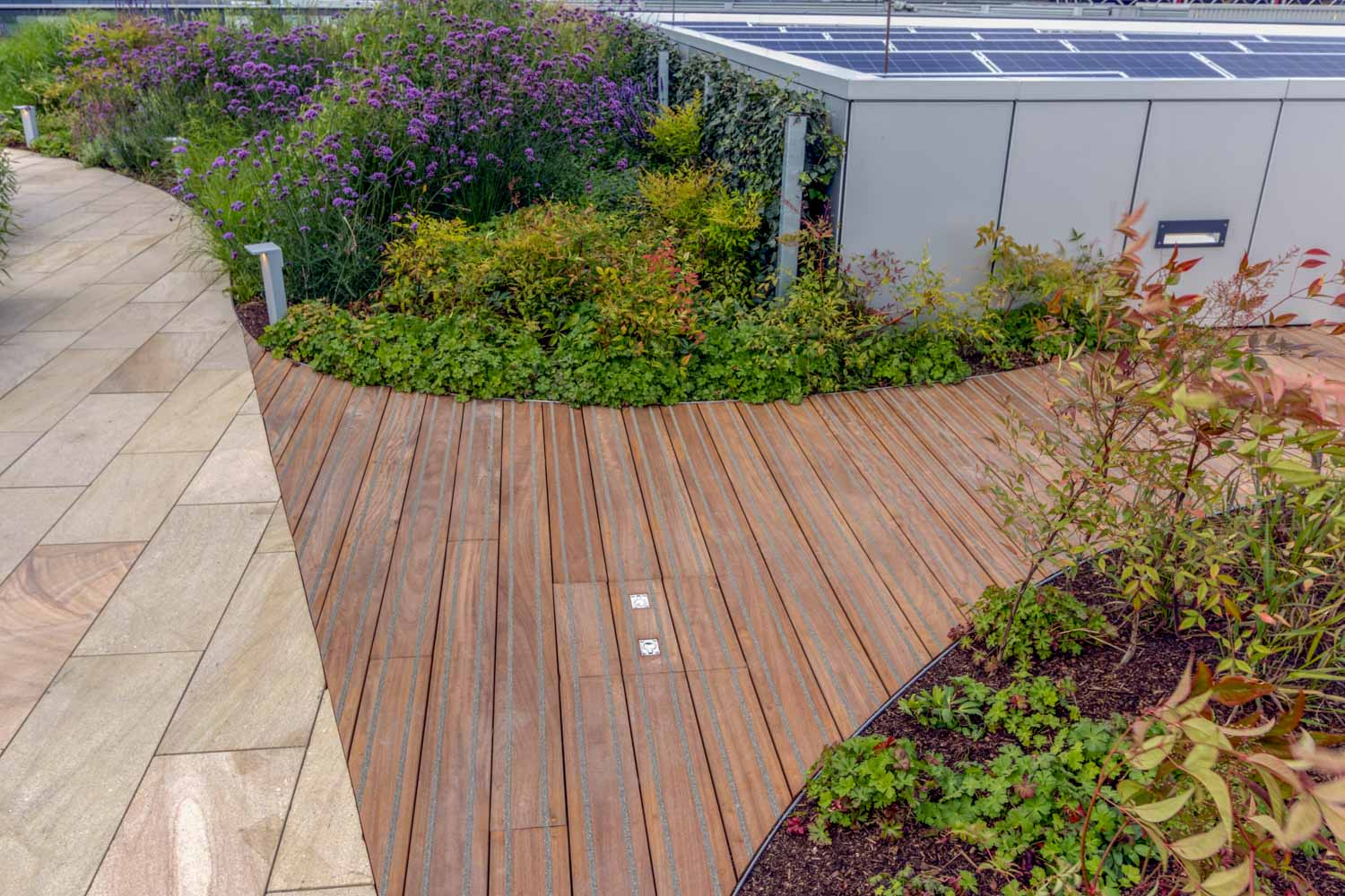 Wooden decking area of roof terrace ensures relaxation for workers