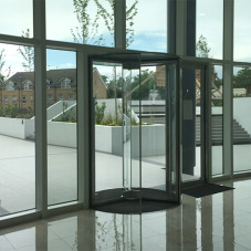 Glass doors, revolving: Revolvedoor automatic entrances